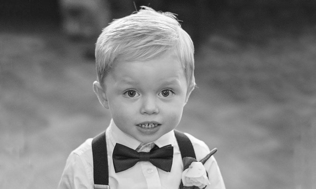 Boy wearing a bow and braces