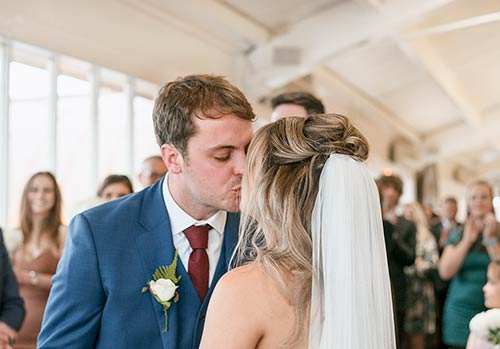 bride-and-groom-first-wedding-cereomony-kiss