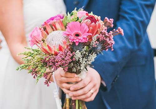 bride-and-groom-holding-wedding-flowers