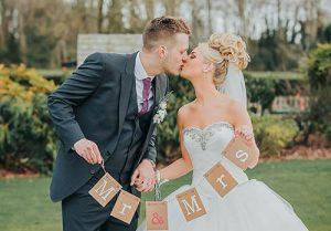 bride-kissing-the-groom-portrait