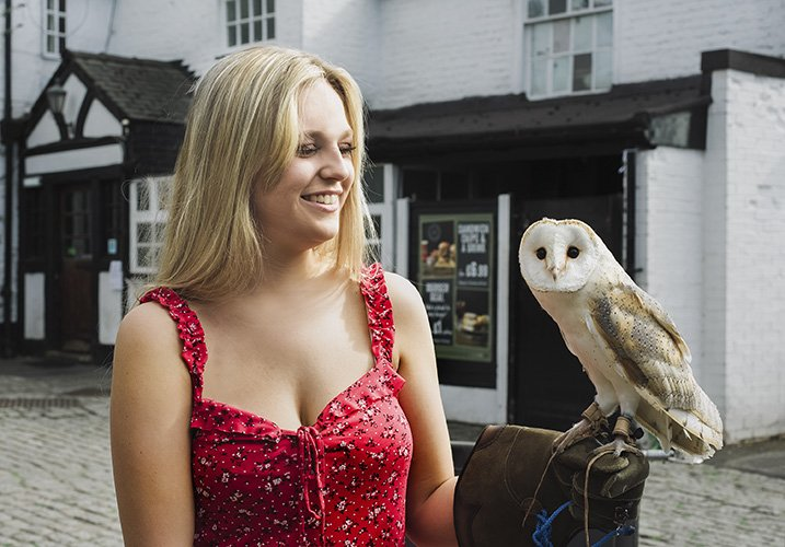 Teen girl holding an owl
