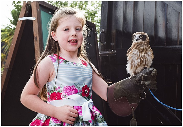 girl holding a baby owl at party