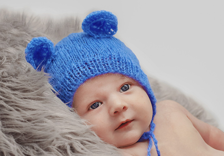 Newborn with teddy hat