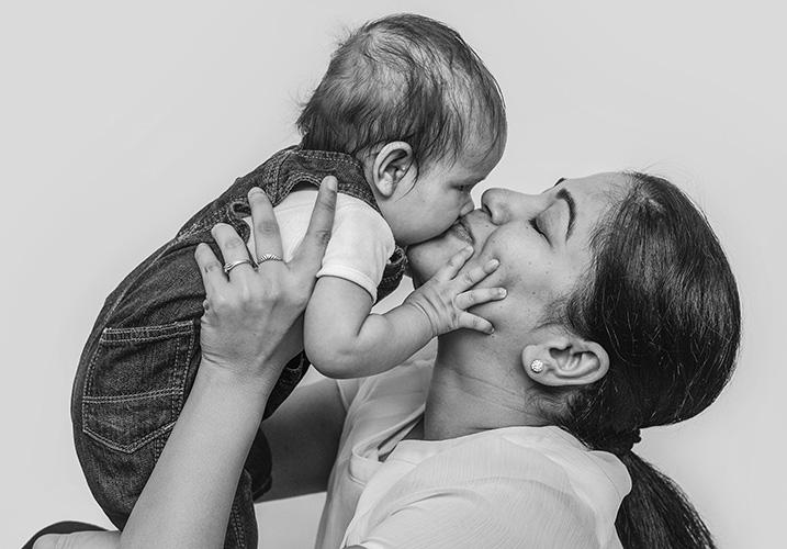 mum kissing her baby boy