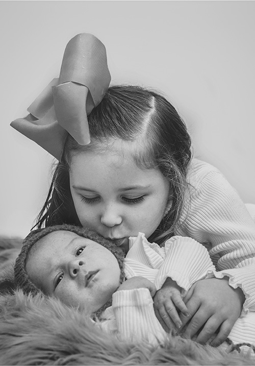 sister with newborn - Childrens Photo Shoot Liverpool