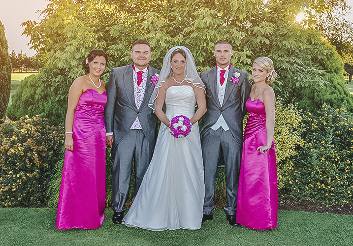 bride and groom photo with there bridesmaids